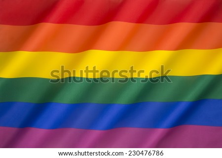 The rainbow flag, commonly the gay pride flag and sometimes the LGBT pride flag, is a symbol of lesbian, gay, bisexual, and transgender (LGBT) pride and LGBT social movements.  - stock photo