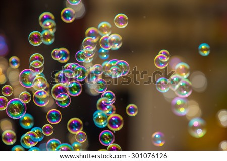 The rainbow soap bubbles from the bubble blower. - stock photo