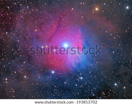 The Raspberry Nebula is an emission and reflection nebula about 1,500 light years away in the constellation Orion - stock photo