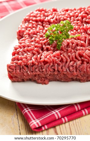 the raw minced meat on kitchen table - stock photo