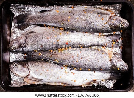 The raw trout prepared for baking close up