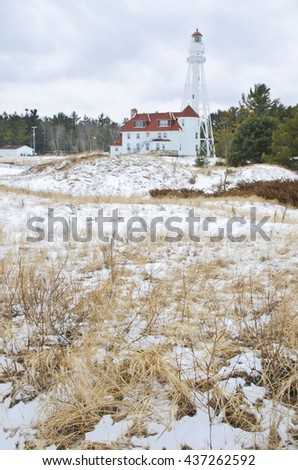The Rawley's Point Lighthouse faces the Lake Michigan shore in winter, Manitowoc County, Wisconsin - stock photo