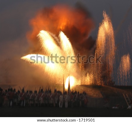 The re enactment of the Siege at Fort Erie from the War of 1812 at Fort Erie, Ontario, Canada, August 12/2006. Showing the explosion in the garrison. - stock photo