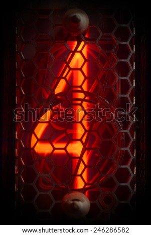 The real Nixie tube indicator of the numbers of retro style.  Digit 4 - stock photo