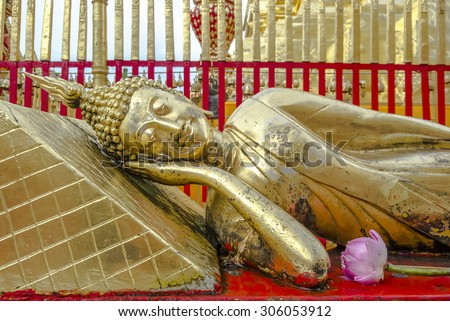 The reclining Buddha in Wat Doi Suthep , Chiang Mai , Thailand  - stock photo