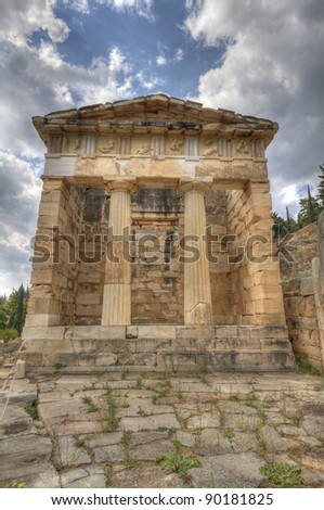 the reconstructed Treasury of Athens at Delphi Greece - stock photo
