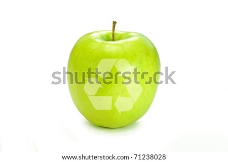 The Recycle symbol on a bright green apple.