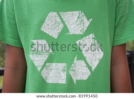The recycle symbol on a green T-Shirt - stock photo