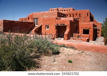 The red classic Adobe house - stock photo