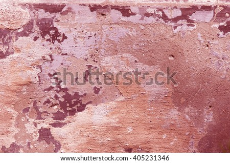 The red concrete wall with crumbling plaster. textural composition - stock photo