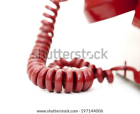 The red cord of an old fashion telephone.