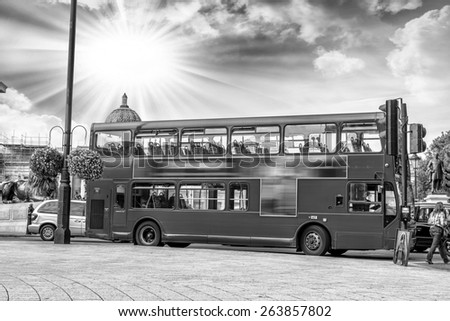The red double decker bus. - stock photo
