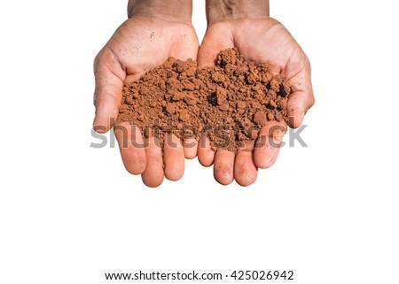 The red dry soil on hands, white background. - stock photo