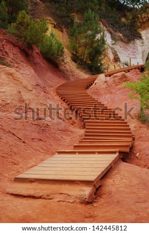 The red ocher walk with wooden stairs in Roussillon, Provence, France - stock photo
