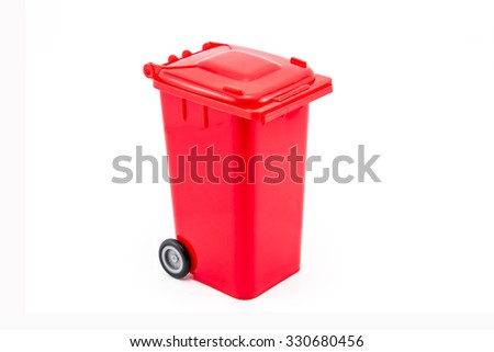 The red recycling bin on white background - stock photo