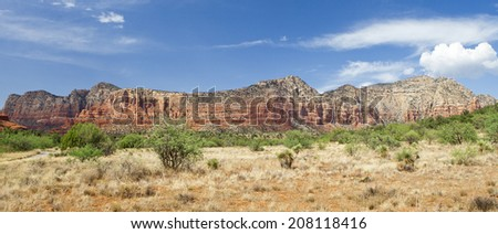 The Red Rocks of Sedona, panorama view of the Lee Mountain Summit with beautiful cloudscape formation - stock photo