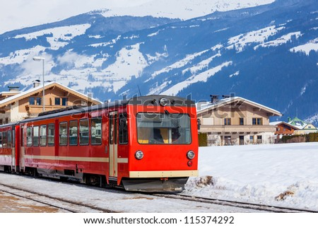 The red train on the Alpine skiing resort in Austria Zillertal. - stock photo
