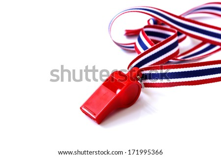 The red whistle isolated on the white background - stock photo