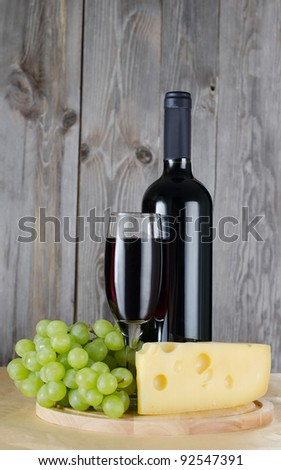 The red wine glass against wooden boards - stock photo