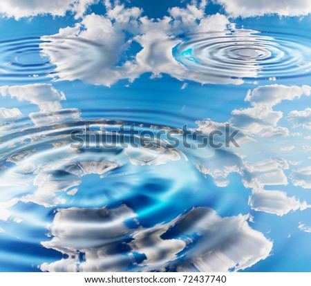 the reflection of blue sky in pure water - stock photo