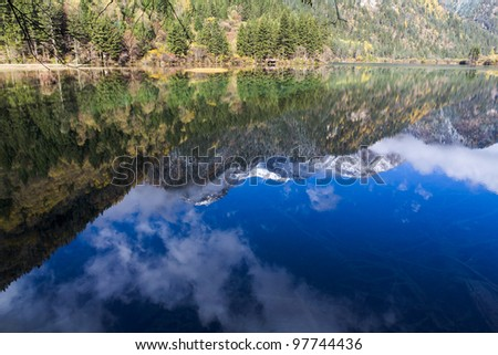 The reflection of blue sky in the lake. - stock photo