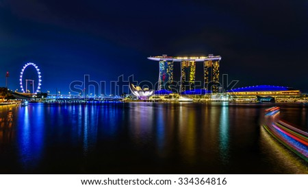 The reflection of Singapore City Skyline along Singapore River at Blue Hour - stock photo