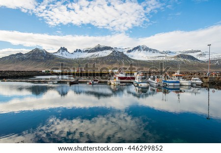 The reflection of Stodvarfjordur mountain range and the bay of Stodvarfjordur town of East Iceland.