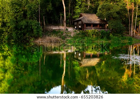 The reflection of the house in water, Krathing Waterfall, Chantaburi, Thailand