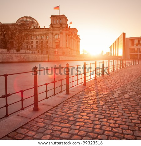 The Reichstag building (Bundestag), famous landmark in Berlin and housing the German Government with spree reflection - stock photo