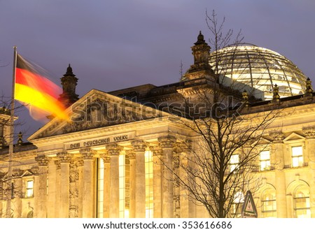 The Reichstag building in Berlin housing the German parliament , at night