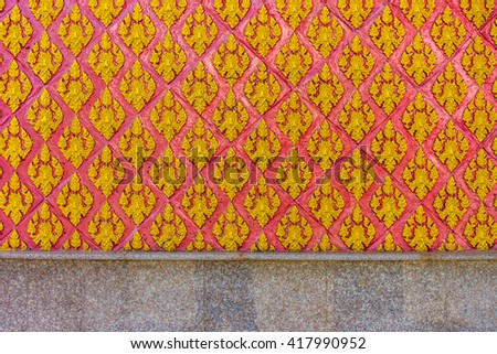The religion art on Thai Temple wall - stock photo