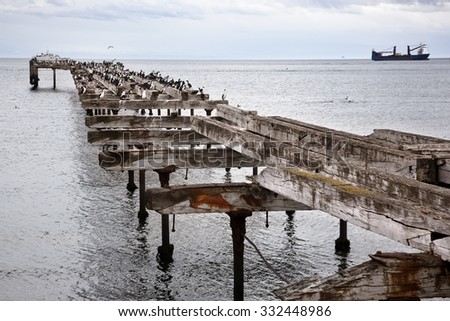 The remains of an old pier, now a resting place for seabirds. Sand Point, Chilean Patagonia. - stock photo