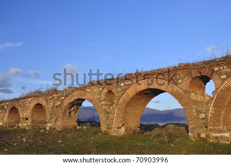 The remains of an old roman aqueduct near city of Skopje - stock photo