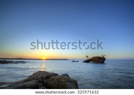 The remains of an old vessel long forgotten. - stock photo