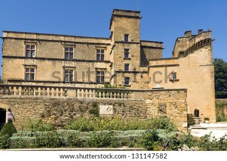 the renaissance Lourmarin Castle ( chateau de lourmarin ), Provence, region of Luberon, France - stock photo