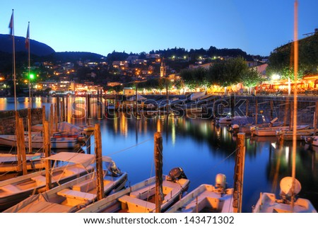 The resort of Ascona on Lake Maggiore in the canton of Ticino, Switzerland at twilight. - stock photo