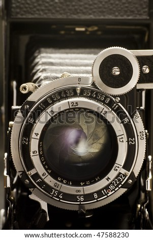 the retro lens from an old camera - stock photo