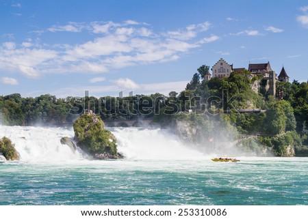 The Rhine Falls in Schaffhausen, Switzerland. The Rhine Falls is the largest waterfall in Europe. - stock photo