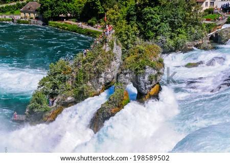 The Rhinefall near Schaffhausen, Switzerland is the biggest waterfall in Europe - stock photo