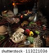 The richly laid table dishes of Georgian cuisine, lots of delicious food,wine,fruits and roasted meat - stock photo