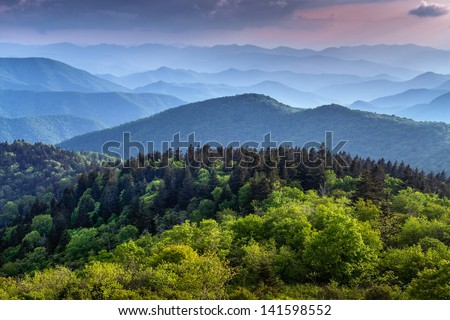 The ridges of the Great Smokey Mountains extending across the valley on the BLue Ridge Parkway near Asheville and Cherokee, North Carolina. - stock photo