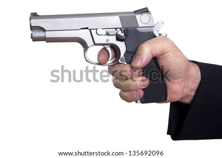 The right hand of a mature adult man wearing a suit, holding a 9mm gun with both hands aiming it to the target. Isolated on white background.