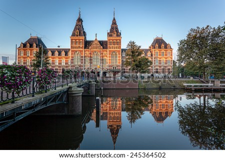 The Rijksmuseum is a Netherlands national museum dedicated to arts and history in Amsterdam. The museum is located at the Museum Square in the borough Amsterdam South, close to the Van Gogh Museum. - stock photo