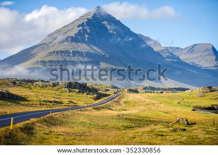 The Ring Road in Iceland. Route 1 or the Ring Road is a national road in Iceland that runs around the island and connects most of the inhabited parts of the country. The length of the road is 1332 km. - stock photo