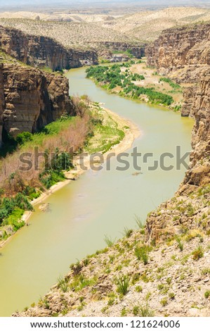 The Rio Grande River flowing through Hot Springs Canyon along the Mexican border in Big Bend National Park - stock photo