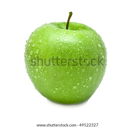 The ripe green apple covered by water drops. Isolation, shallow DOF.