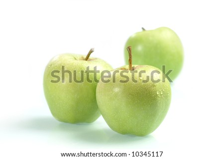 The ripe juicy apples covered by drops of water. Isolation on white, shallow DOF - stock photo