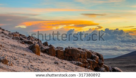 The rising of the sun from the volcano Mawenzi. View from the slopes of Kilimanjaro - Tanzania, Africa - stock photo