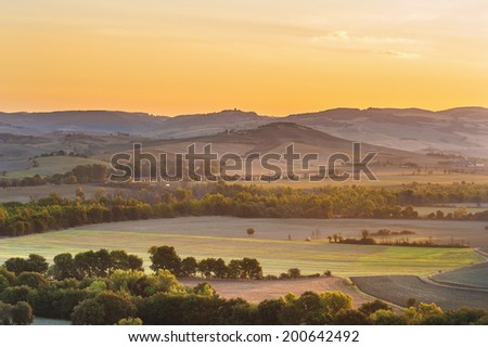 The rising sun over the Tuscan fields - stock photo