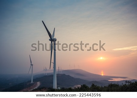 the rising sun shine in wind farm by the lake